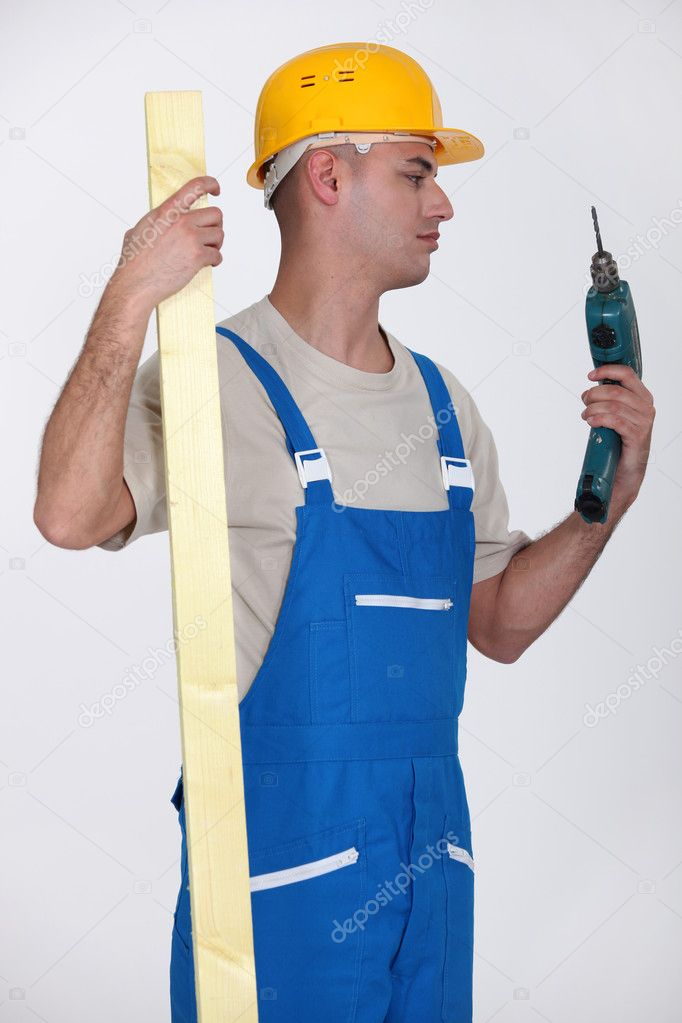 Man looking at drill — Stock Photo #10900516