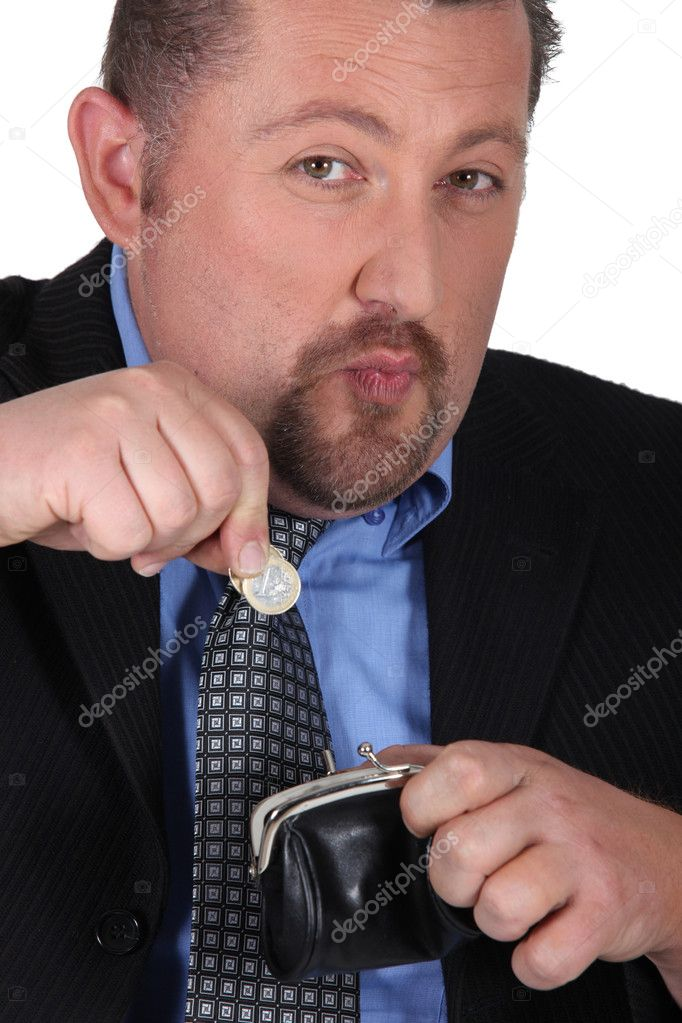 Close up shot of moonfaced man with lady&#039;s purse  Stock Photo #10906673