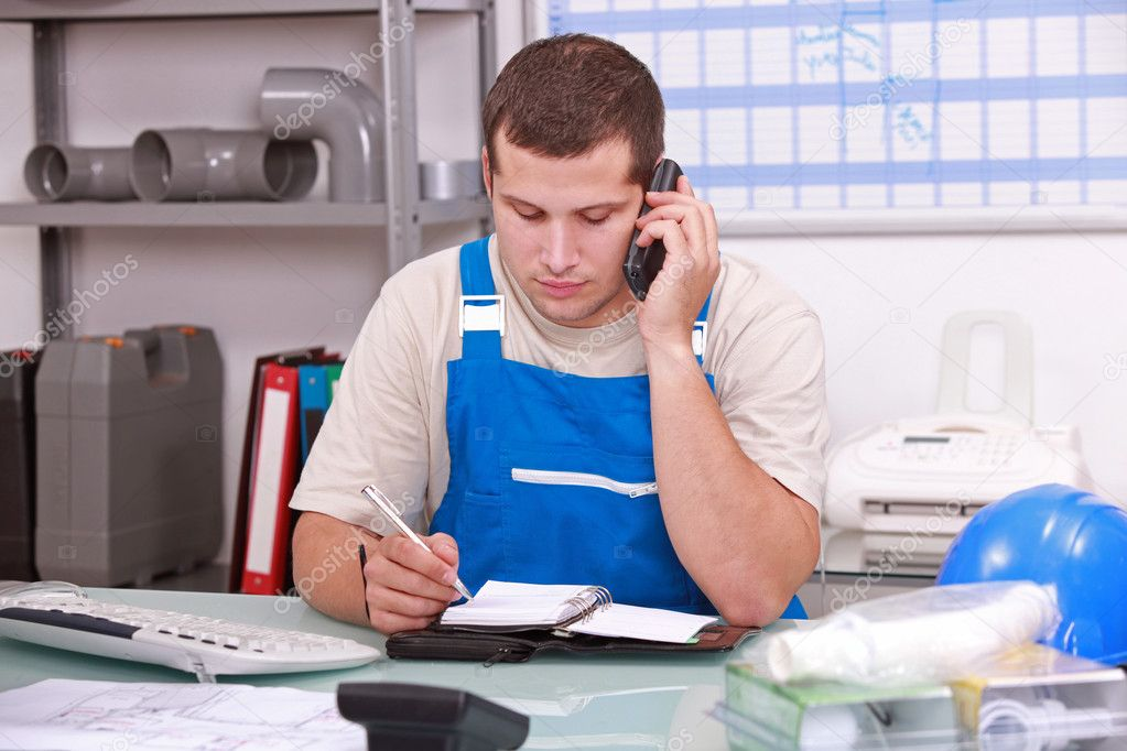 Man checking stock and ordering new parts — Stock Photo #10908659