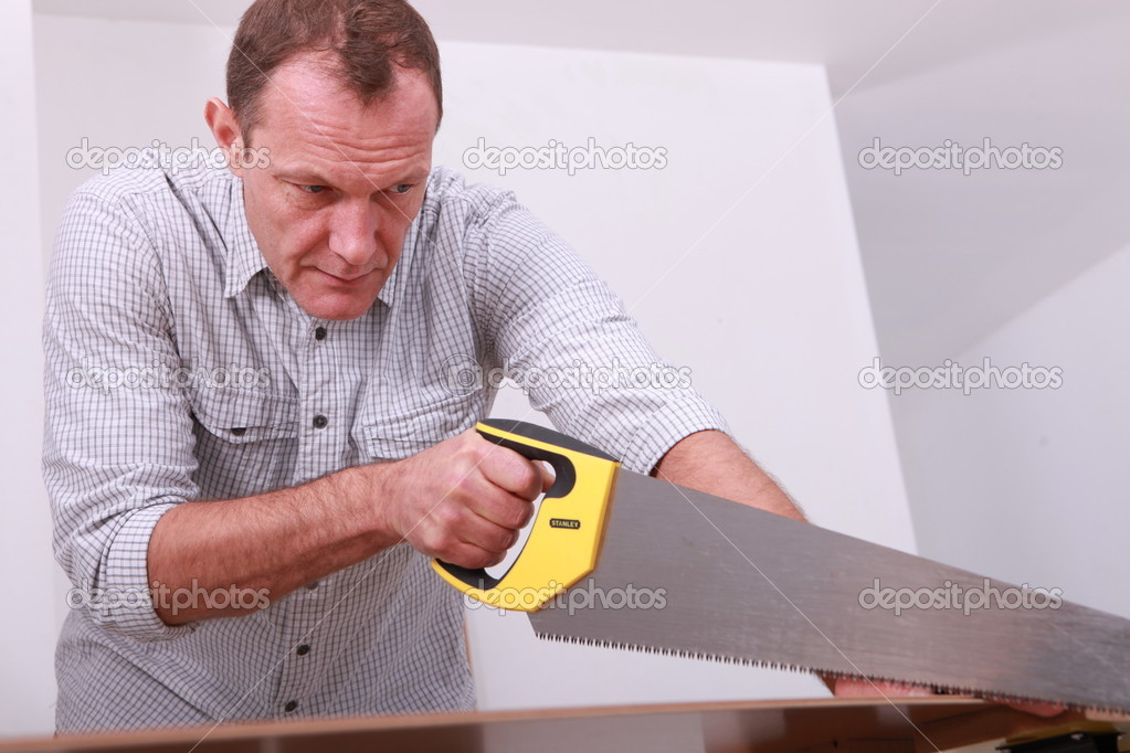 Handyman with hand saw — Stock Photo #10909138