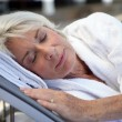 Elderly woman sleeping — Stock Photo
