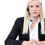Blonde woman wearing a telephone headset — Stock Photo #10910912