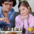 Mother and daughter playing chess — Photo