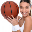 Brunette holding basketball — Stock Photo #10911956
