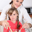 Mother and daughter preparing salad — Stock Photo #10912287
