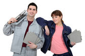 Couple with tile cutting equipment — Stock Photo