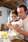 Father and daughter at breakfast — Stock Photo