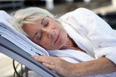 Elderly woman sleeping — Stock Photo