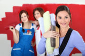 Three women home decorating — Stok fotoğraf