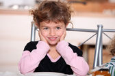 Girl sitting at table — Stock Photo