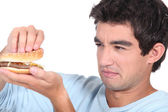 Man holding cheeseburger — Stock Photo