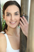 Portrait of woman with bamboo — Stock Photo