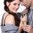 Couple toasting with champagne - Stock Photo