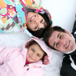Family laying in the snow — Stock Photo