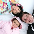 Family laying in the snow — Stock Photo #10963504