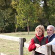 Couple by a paddock — Stock Photo