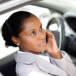 Businesswoman making a call whilst in parked car — Stock Photo