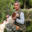 Stock Photo: Hunter with dog