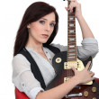 Stock Photo: Young womplaying guitar