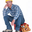 Bored builder sat on tool-box — Stock Photo