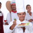 Female chef presenting plate — Stockfoto #10967793