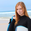 Redhead girl with surfboard — Stock Photo