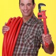 Plumber with a pipe wrench — Stock Photo