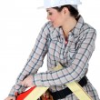 Stock Photo: Womusing carpentry plane