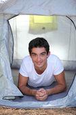 Boy lying in tent — Stock Photo
