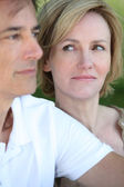 Woman glancing at her husband — Stock Photo