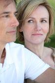 Woman glancing at her husband — Stock Photo