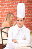 Cook sitting in a restaurant — Stock Photo