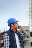 Tradesman working on a construction site — Stock Photo