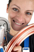 Plumber with copper pipe and bending tool — Stock Photo
