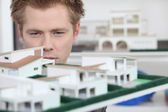 Property developer inspecting model — Stock Photo
