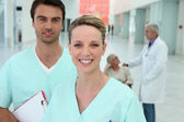 Doctors in hospital hallway — Stock Photo