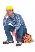 Bored builder sat on tool-box — Stock Photo