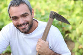 Man with hoe — Stock Photo