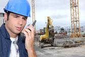 Laborers communicationg with radio — Foto Stock