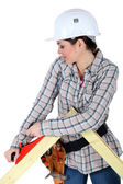 Woman using a carpentry plane — Stock Photo