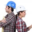 Male and female builders back to back — Stock Photo #10970158