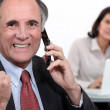 Successful businessman on phone — Stock Photo #10970180