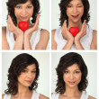 Photo booths of young brunette with red heart — Stock Photo