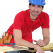 Construction worker leaning against his workbench — Stock Photo #10970988
