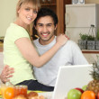 Affectionate young couple in the kitchen — Stock Photo