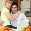 Affectionate young couple in the kitchen — Stock Photo #10971238