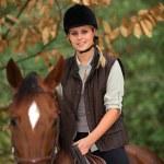 Young girl riding a horse — Stock Photo #10971686