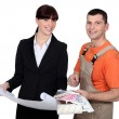 Painter standing next to an engineer — Stock Photo #10972125