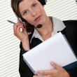 Call-center agent holding folder — Stock Photo #10972222