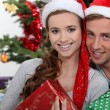 Couple of teenagers at Christmas. — Stock Photo #10972260